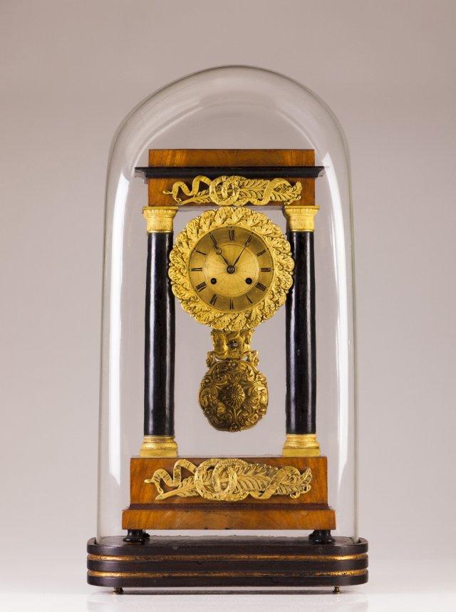 A 19th century Empire table clock