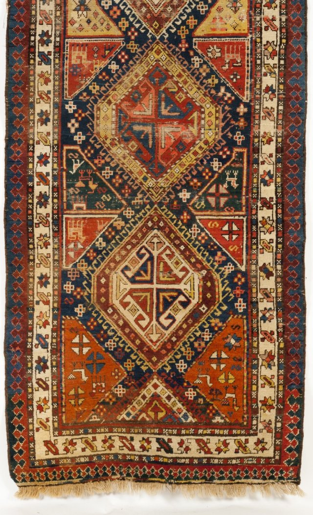 An antique Kazak cotton and wool carpet