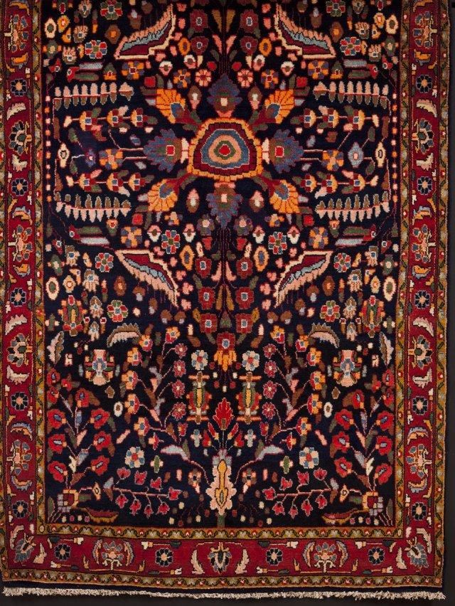 A Ilam Persian carpet