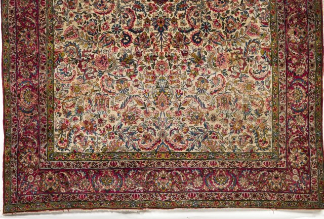A Persian Sarooq cotton and wool carpet