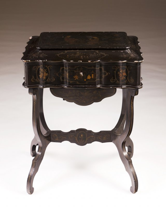 A 19th century Chinese lacquered work table