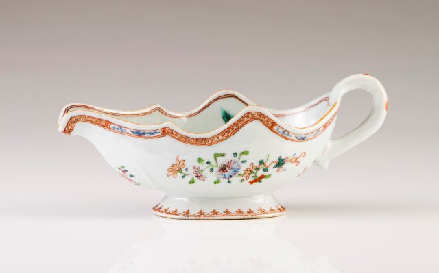 A scalloped sauce boat