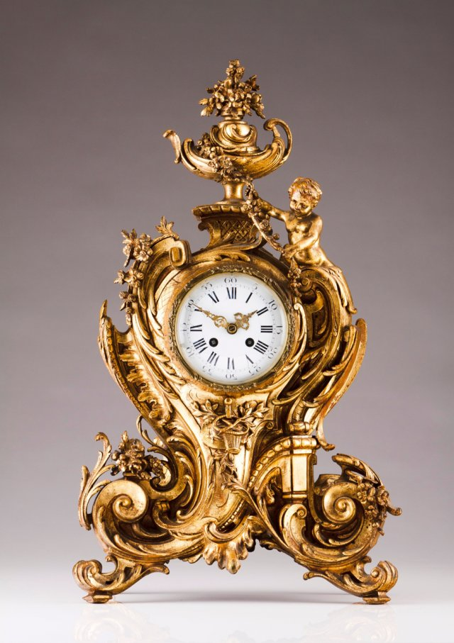 A Louis XV style table clock