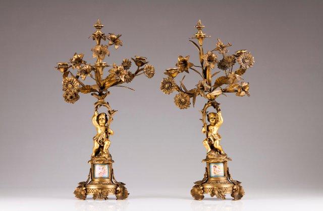 A pair of three-light candelabra