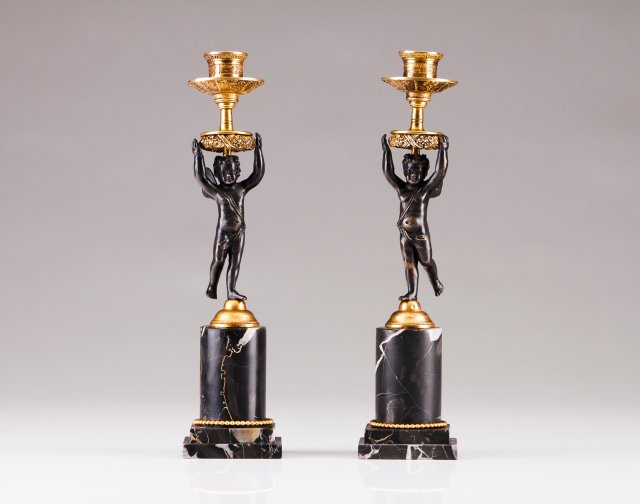 A pair of late 19th, early 20th century candlesticks