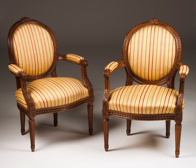A pair of Louis XVI style fauteuils