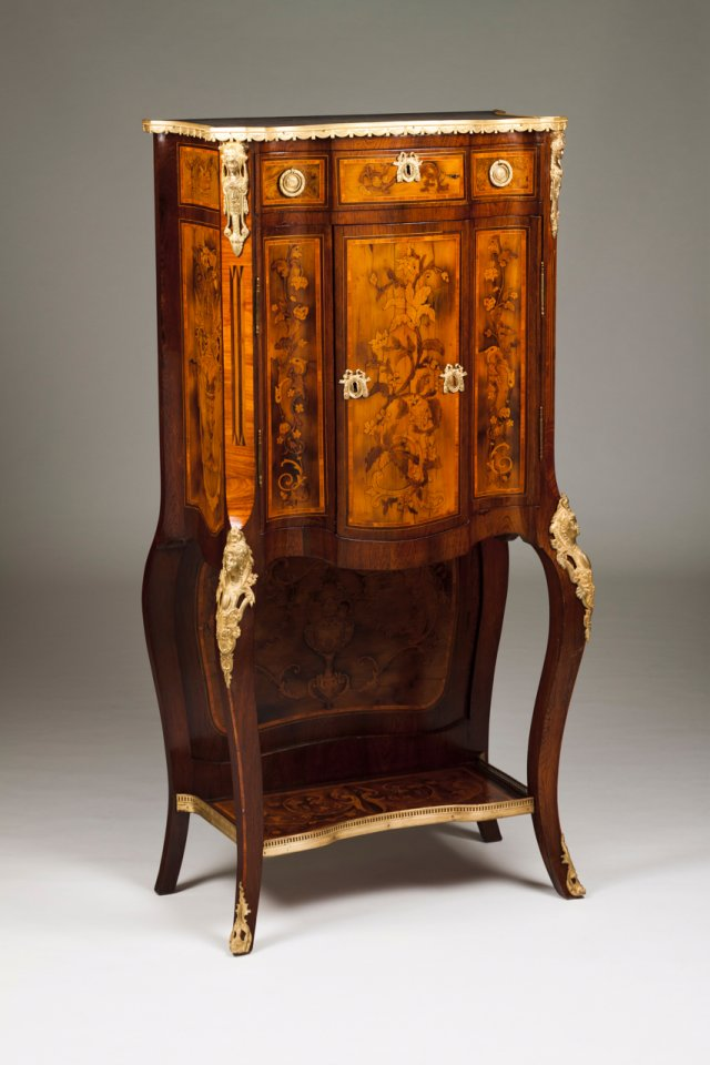 A Louis XVI style cabinet