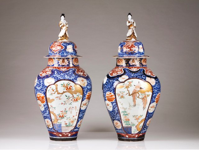 A pair of vases with covers