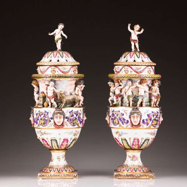 A pair of baluster vases with cover