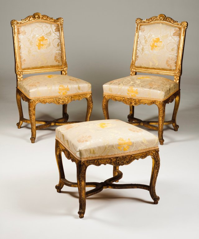 A pair of Louis XV/Louis XVI style chairs and stool