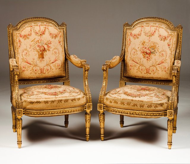 A Louis XVI style settee and pair of fauteuils