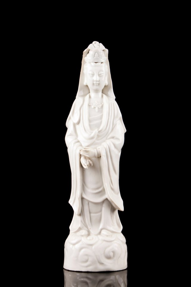 A Chinese Dehua (blanc-de-chine) porcelain sculpture of Guanyin