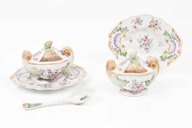 A pair of tureens with covers, dishes and spoon