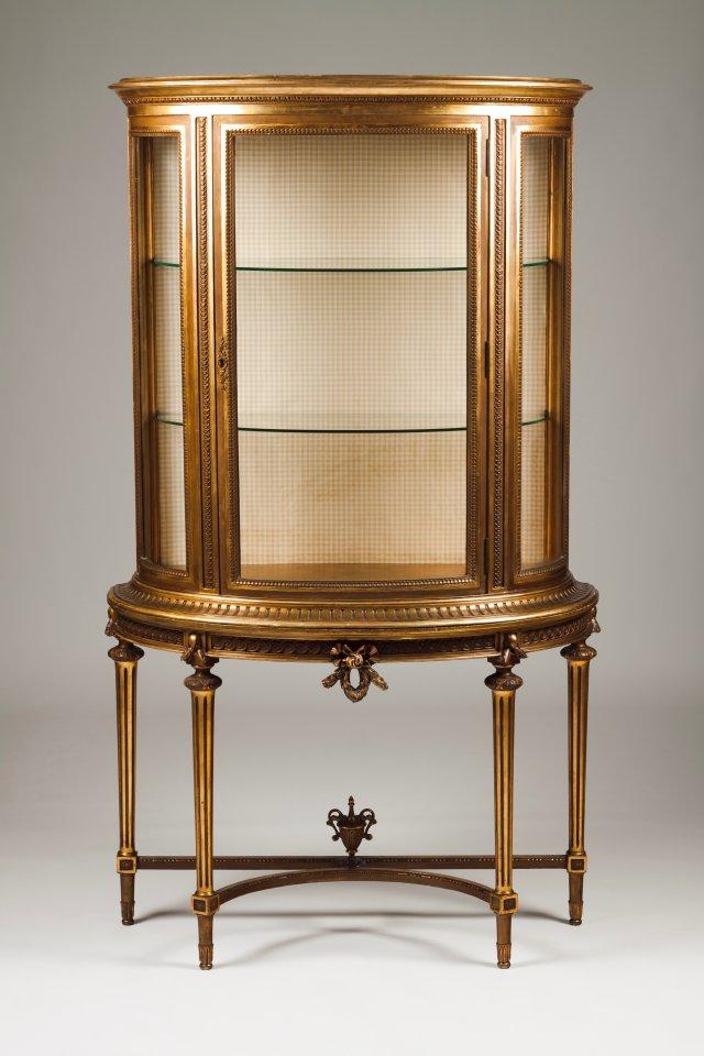 A Louis XVI style demi-lune showcase