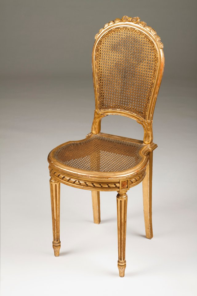 A Louis XVI style sewing chair