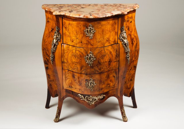 A small Louis XV style serpetine commode