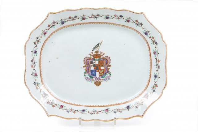A large scalloped rim platter