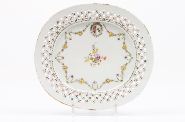 An oval, pierced decoration plate