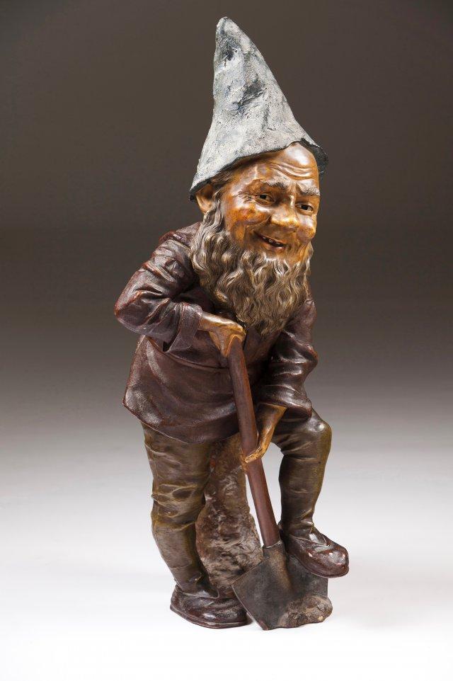 A garden gnome with a shovel