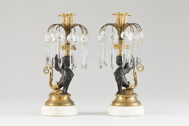 A pair of Regency candle stands