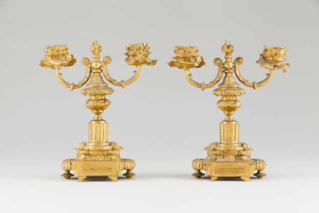A pair of two branch candelabra