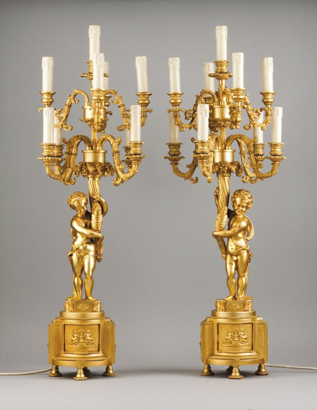 A pair of Louis XVI style nine light candelabra