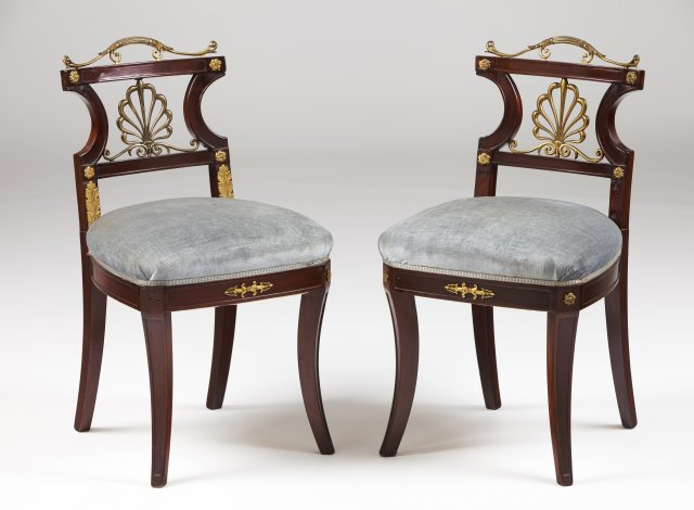 A pair of Empire style chairs