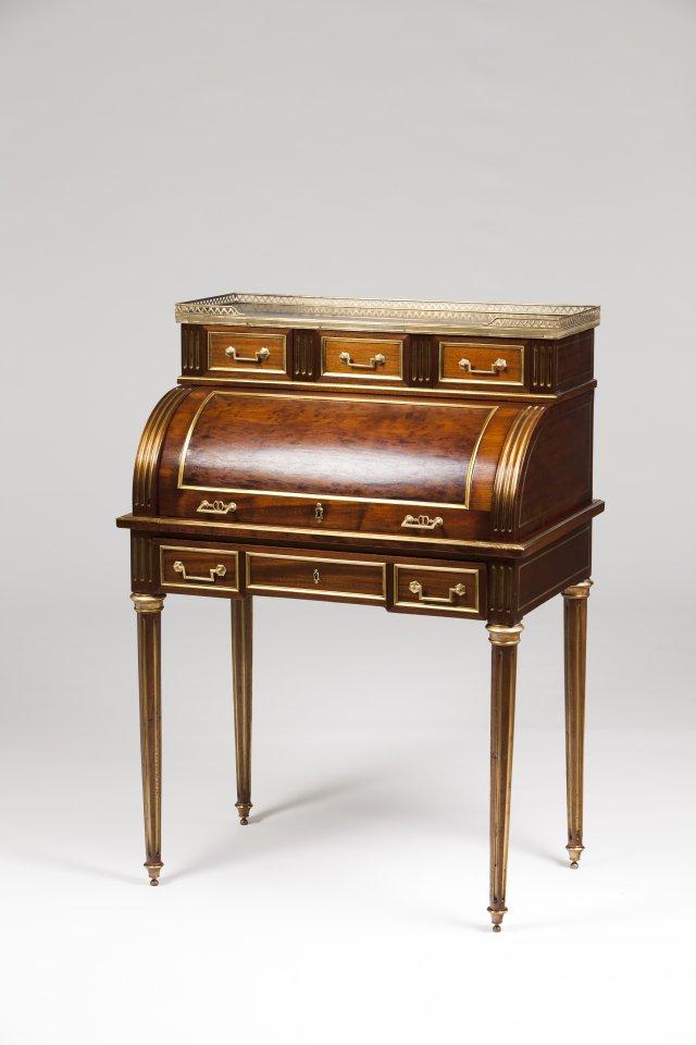 A small Louis XVI roll top desk