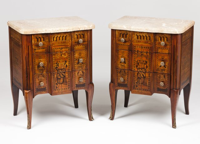 A pair of Louis XV/XVI style bedside cabinets