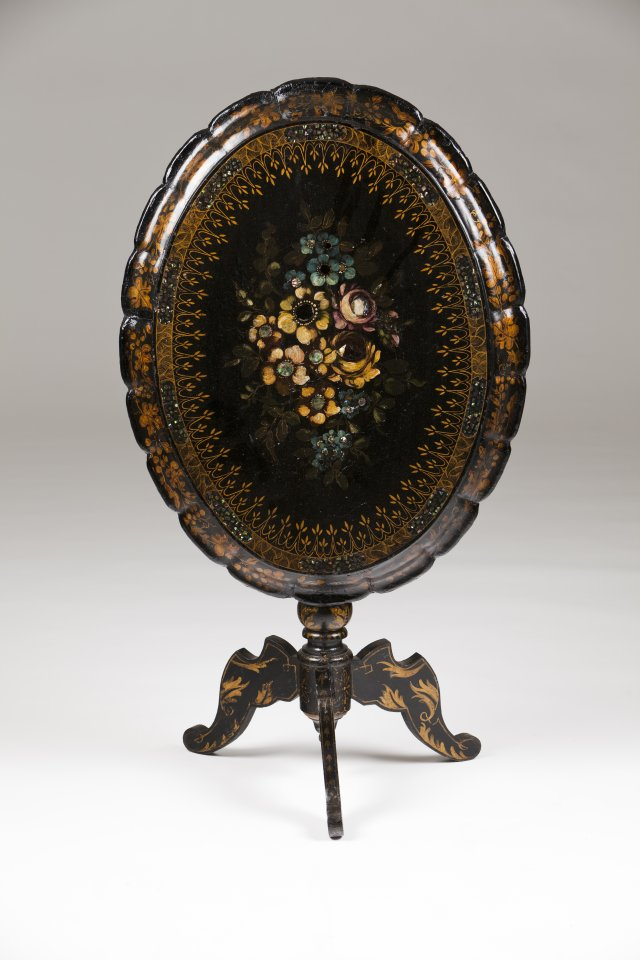 A Victorian tripod table