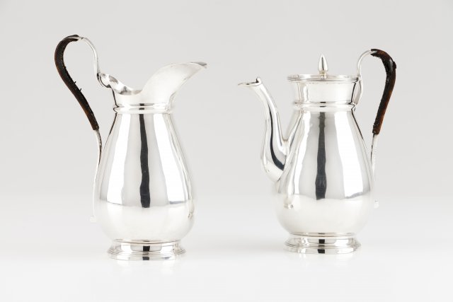 A milk jug and coffee pot with cover
