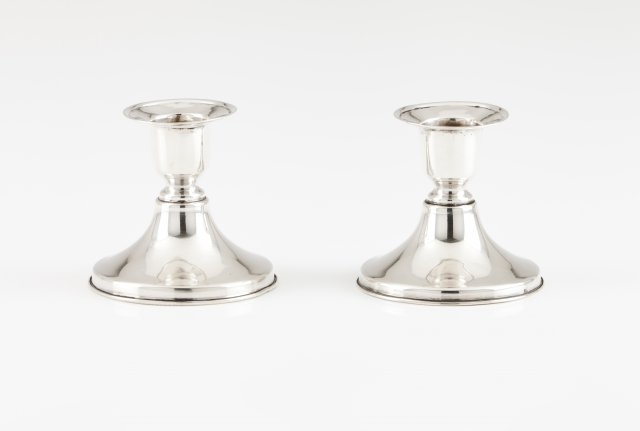 A pair of piano candlesticks